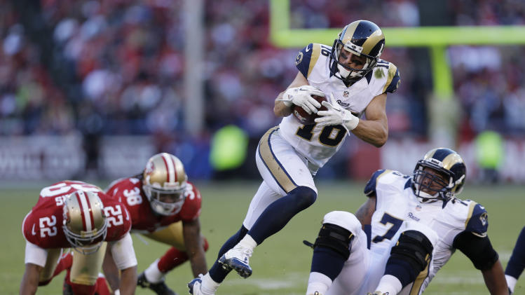 St. Louis Rams wide receiver Danny Amendola carries the ball past San Francisco 49ers cornerback Carlos Rogers (22) and free safety Dashon Goldson (38) during the third quarter of an NFL football game in San Francisco, Sunday, Nov. 11, 2012. At right is St. Louis Rams tackle Rodger Saffold. (AP Photo/Marcio Jose Sanchez)