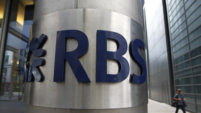 FILE - In this Friday, Aug. 3, 2012 file photo, a woman walks by an office of Royal Bank of Scotland (RBS) in the City of London.  U.S. and U.K. authorities fined the Royal Bank of Scotland more than $610 million Wednesday for its role in the manipulation of a key global interest rate — with the bank pledging to make the rate-riggers and their managers foot the bill. (AP Photo/Sang Tan, File)