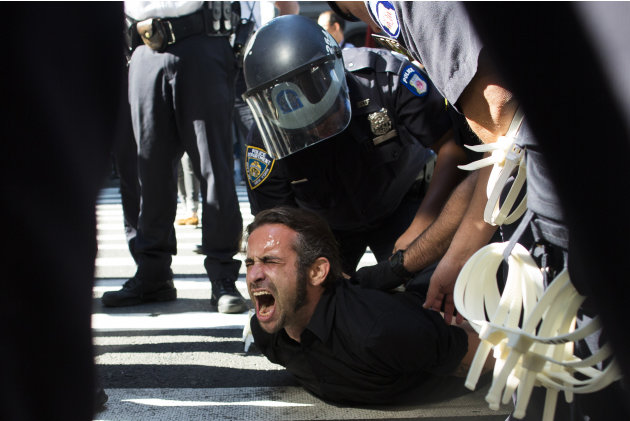 Occupy Wall Street protestor Chris Philips screams as he is arrested near Zuccotti Park, Monday, Sept. 17, 2012, in New York. Multiple Occupy Wall Street protestors have been arrested during a march t