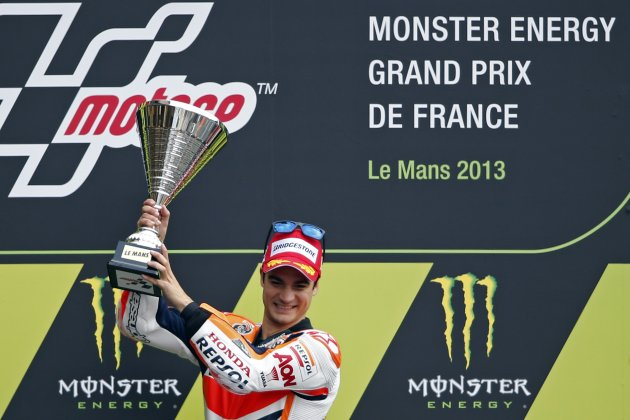 Honda MotoGP rider Dani Pedrosa of Spain celebrates on podium after winning the French Grand Prix in Le Mans circuit, central France