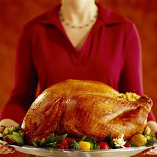 Woman holding a Thanksgiving turkey