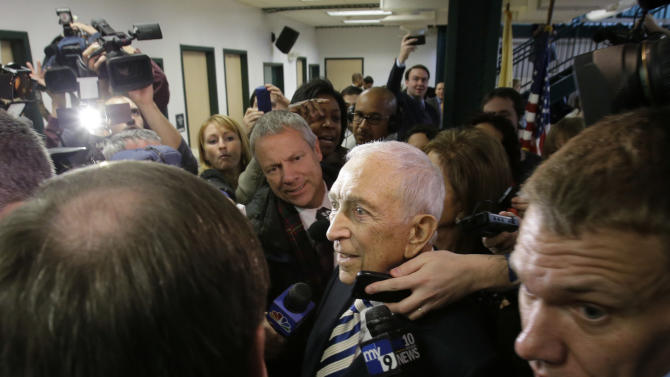 Sen. Frank Lautenberg, 89, center, the oldest member of the U.S. Senate, is surrounded by media Friday, Feb. 15, 2013, in his hometown of Paterson, N.J., after announcing his plans to retire at the end of his current term. His decision eliminates a probable primary battle with Cory Booker, the charismatic mayor or Newark, and possibly others including Democratic Rep. Frank Pallone, who is also mulling a run. (AP Photo/Mel Evans)