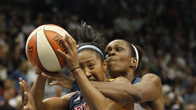 Indiana Fever guard Briann January (20) is fouled by Minnesota Lynx forward Taj McWilliams-Franklin (8) in the second half of Game 2 of the WNBA basketball Finals Wednesday, Oct. 17, 2012, in Minneapolis. The Lynx won 83-71. (AP Photo/Stacy Bengs)