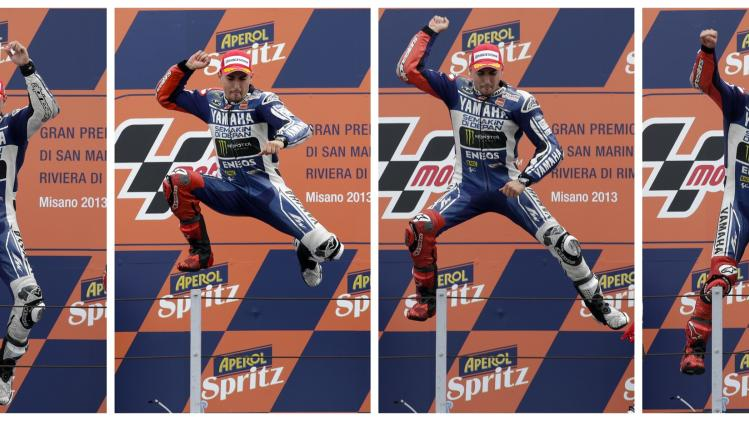 A combination of pictures shows Yamaha MotoGP rider Lorenzo jumping as he celebrates on the podium after winning the San Marino Grand Prix in Misano circuit