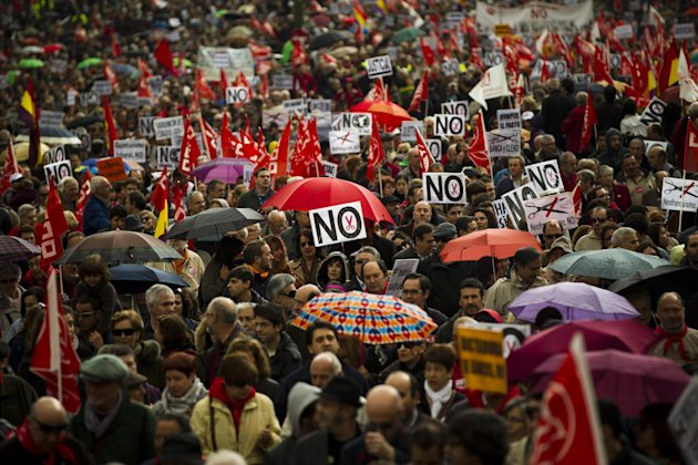 People take part on a protest during the May Day rally in the center of Madrid, Tuesday, May 1, 2012. Tens of thousands of workers marked May Day in European cities Tuesday with a mix of anger and glo