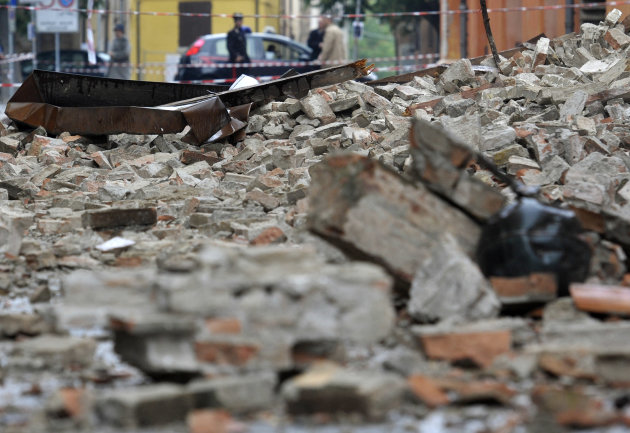 Debris of collapsed buildings block a road in Finale Emilia northern Italy, Sunday, May 20. 2012. A magnitude 6 earthquake shook northern Italy early Sunday at 4:04 a.m. Sunday between Modena and Mantova, about 35 kilometers (22 miles) north of Bologna at a relatively shallow depth of 10 kilometers (6 miles). (AP Photo/Marco Vasini)