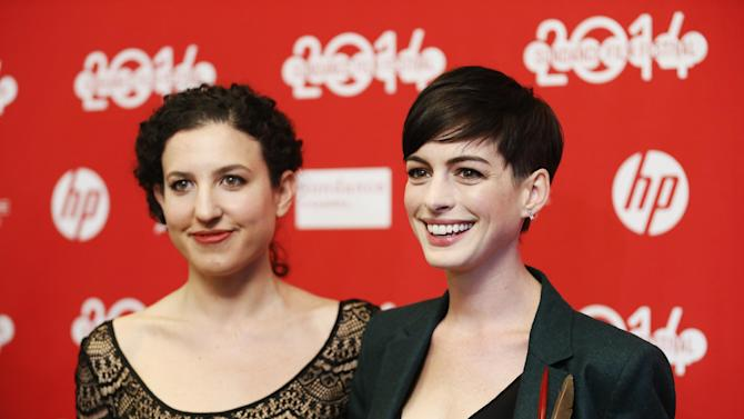 """FILE - In this Mon., Jan. 20, 2014 file photo, writer and director Kate Barker-Froyland, left, and cast member Anne Hathaway, pose together at the premiere of the film """"Song One"""" during the 2014 Sundance Film Festival, in Park City, Utah. (Photo by Danny Moloshok/Invision/AP, File)"""
