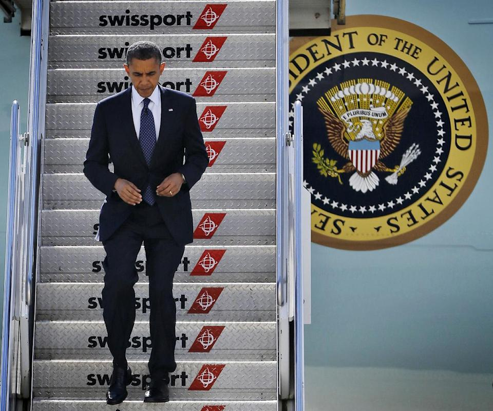 President Barack Obama steps off Air Force One upon his arrival, Monday, Sept. 24, 2012, at JFK airport in New York. (AP Photo/Pablo Martinez Monsivais)