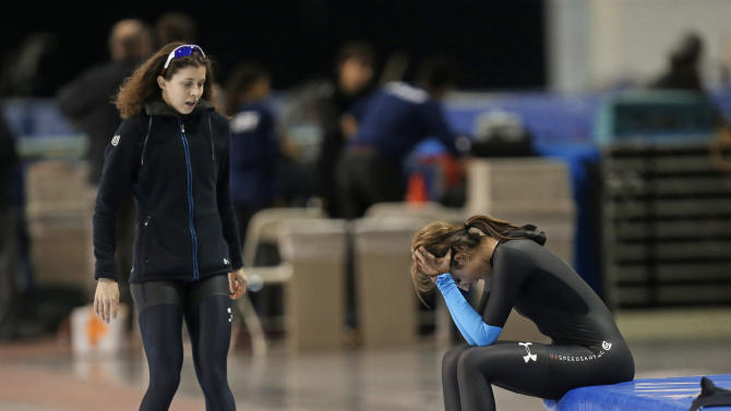 First-place finisher Maria Lamb, left, skates up to Petra Acker after competing in the women's 5,000 meters during the U.S. Olympic speedskating trials Wednesday, Jan. 1, 2014, in Kearns, Utah. (AP Photo/Rick Bowmer)