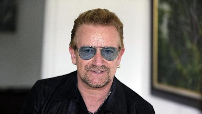 "Irish rock star Bono speaks during an interview with the Associated Press in Lagos, Nigeria Friday, Aug. 28, 2015, African stars and rock star Bono say music can help push for the empowerment of women globally. Bono and the top African male musicians D'banj, Diamond and Banky W announced Friday that they will be included in a remix of the song ""Strong Girl"" - a rallying cry for women's empowerment which features top African female talent. (AP Photo/Sunday Alamba)"
