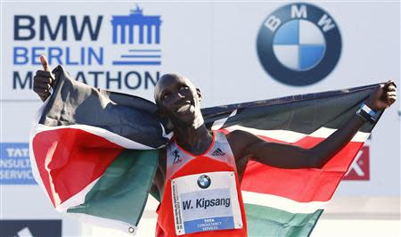 Kipsang of Kenya reacts after winning 40th Berlin marathon