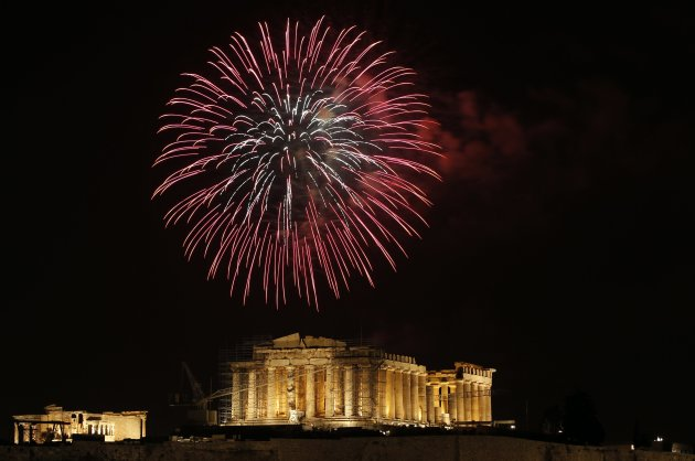 Fireworks explode over the temple of the Parthenon during New Year's day celebrations in Athens