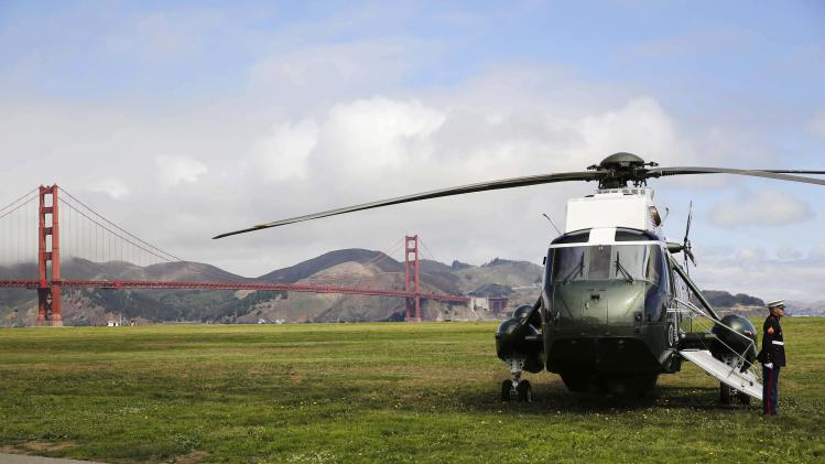 Marine One awaits for U.S. President Barack Obama with the Golden Gate Bridges in the background in San Francisco