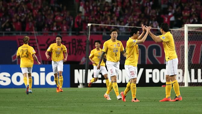 Guangzhou Evergrande players celebrate after scoring a goal against Japan's Cerezo Osaka during the AFC Champions League round 16 match in Osaka on May 6, 2014