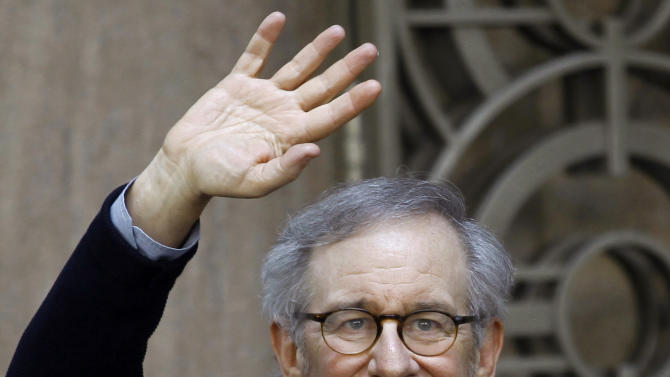 "Director Steven Spielberg waves to the media as he leaves Indian Industrialist Anil Ambani's office in Mumbai, India, Monday, March 11, 2013. Spielberg is in India to celebrate the success of his Oscar-winning film ""Lincoln"" co-produced by Ambani's Reliance Entertainment. (AP Photo/Rafiq Maqbool)"