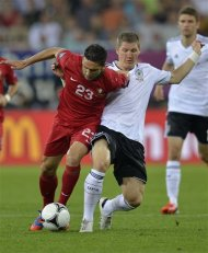 Portugal&#39;s Helder Postiga, left, and Germany&#39;s Bastian Schweinsteiger fight for the ball during the Euro 2012 soccer championship Group B match between Germany and Portugal in Lviv, Ukraine, Saturday, June 9, 2012. (AP Photo/Martin Meissner)