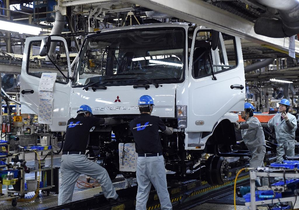Japan factory output turns down in July as China demand slumps
