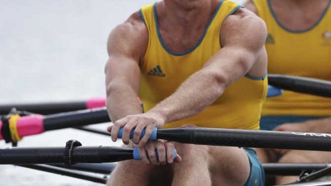 Australia's Daniel Noonan holds the roars as he waits for the start of a men's quadruple rowing sculls heat in Eton Dorney, near Windsor, England, at the 2012 Summer Olympics, Saturday, July 28, 2012. (AP Photo/Armando Franca)