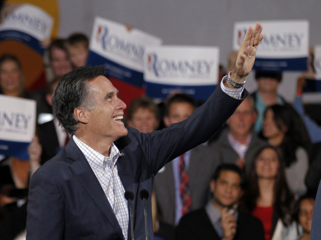 Republican presidential candidate former Massachusetts Gov. Mitt Romney arrives for an election night rally in Denver, Tuesday, Feb. 7, 2012. (AP Photo/Chris Carlson)