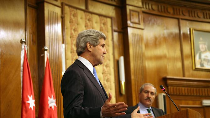 "U.S. Secretary of State John Kerry, left, speaks during a joint news conference with his Jordanian counterpart, Nasser Judeh, right, in Amman Wednesday, May 22, 2013. Secretary of State John Kerry says the United States and its Arab and European allies will step up their support for Syria's opposition to help them ""fight for the freedom of their country"" if President Bashar Assad's regime doesn't engage in peace talks in good faith. (AP Photo/Mohammad Hannon)"