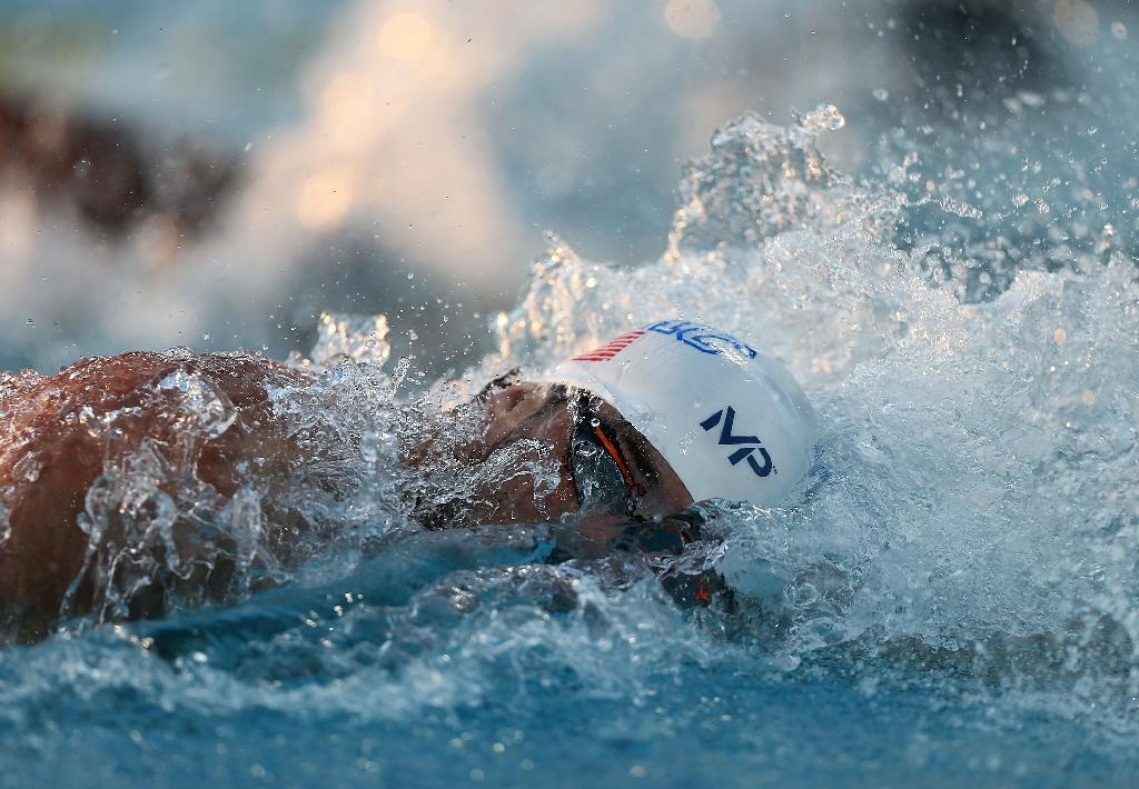 Phelps caps comeback meet with storming 100m free win