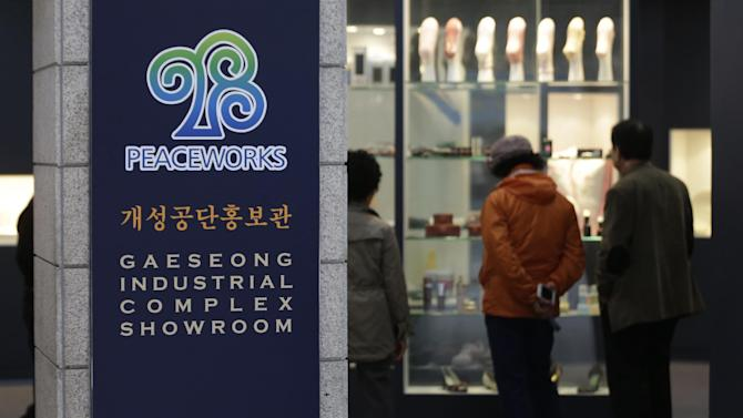 Visitors look at products made at Kaesong industrial complex in North Korea displayed at the complex's showroom at the unification observation post near the border village of Panmunjom, that has separated the two Koreas since the Korean War, in Paju, north of Seoul, South Korea, Thursday, April 18, 2013. The South Korean entrepreneurs who invested up to 10 years and millions of dollars in the Kaesong industrial complex, a symbol of economic collaboration between the rival Koreas that is now shuttered by the North, have little more than hope to cling to as assembly lines sit idle day after day. (AP Photo/Lee Jin-man)
