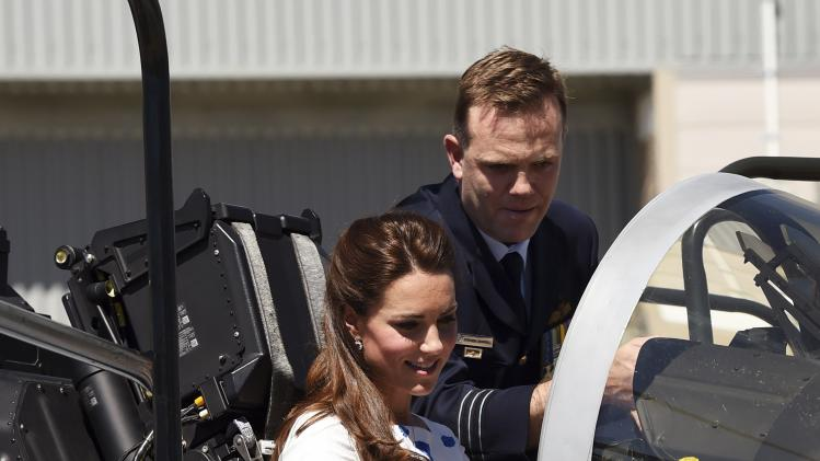 Catherine, the Duchess of Cambridge sits in the cockpit of a RAAF Super Hornet of 1 Squadron alongside Commanding Officer of Number 1 Squadron, Wing Commander Stephen Chappell at RAAF Base Amberley