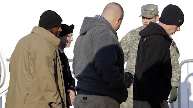 Army Pfc. Bradley Manning, second from left, is escorted from a security vehicle to a courthouse in Fort Meade, Md., Wednesday, Nov. 28, 2012, for a pretrial hearing. Manning is charged with aiding the enemy by causing hundreds of thousands of classified documents to be published on the secret-sharing website WikiLeaks. (AP Photo/Patrick Semansky)