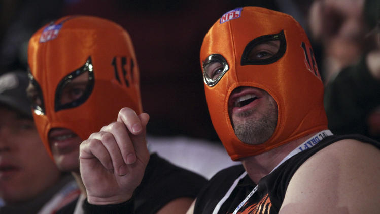 Cincinnati Bengals fans Rick Sparke, left, and Josh Lyons watch the fourth round of the NFL football draft at Radio City Music Hall, Saturday, April 28, 2012 in New York.  (AP Photo/Mary Altaffer)