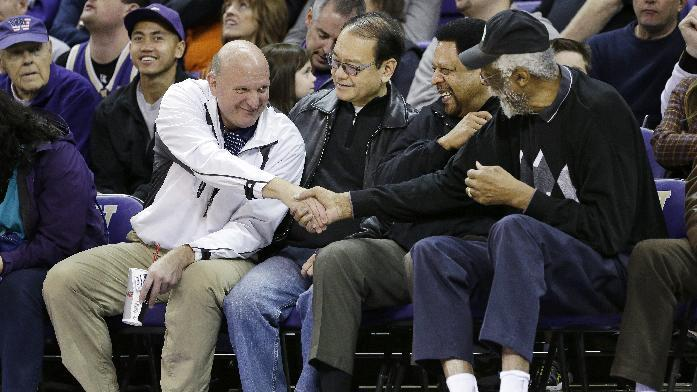"""FILE - In this Jan. 25, 2014, photo, then-Microsoft CEO Steve Ballmer, left, shakes hands with former NBA players Bill Russell, right, and """"Downtown"""" Freddie Brown as Omar Lee looks on during an NCAA college basketball game between Washington and Oregon State in Seattle. An individual with knowledge of negotiations to sell the Los Angeles Clippers said Shelly Sterling has reached an agreement to sell the team to Ballmer for $2 billion. The individual, who wasn't authorized to speak publicly, told The Associated Press on Thursday, May 29, 2014, that Ballmer and the Sterling Family Trust now have a binding agreement. The deal now must be presented to the NBA. (AP Photo/Elaine Thompson, File)"""