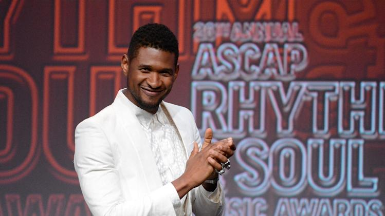 Usher appears on stage at the 26th Annual ASCAP Rhythm & Soul Music Awards on Thursday, June 27, 2013, in Beverly Hills, Calif. (Photo by Phil McCarten/Invision for ASCAP/AP Images)