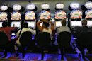 Gamers play the slot machines at the Empire City Casino in Yonkers, New York