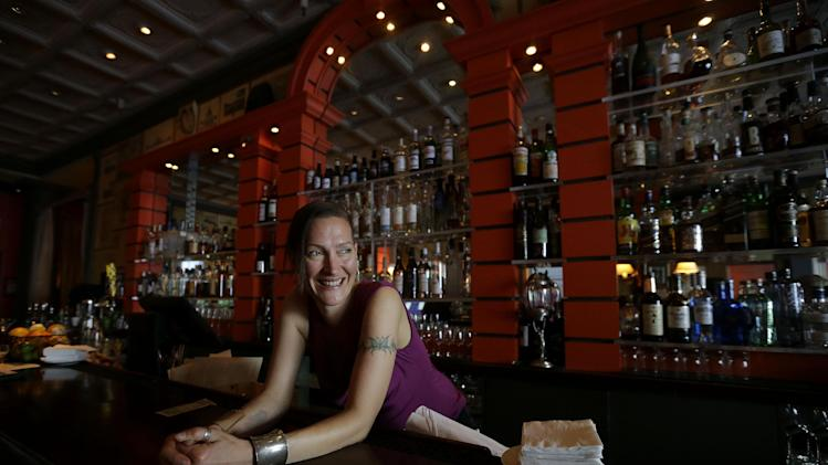 Bartender Valen West smiles while speaking to reporter at Zare at Fly Trap in San Francisco, Wednesday, April 3, 2013. Across California, 2 a.m. is the witching hour for bartenders to issue the last call for drinks. But a proposed state law would give nightlife loving cities the option of allowing their bars and clubs to keep serving drinks for two more hours. (AP Photo/Jeff Chiu)