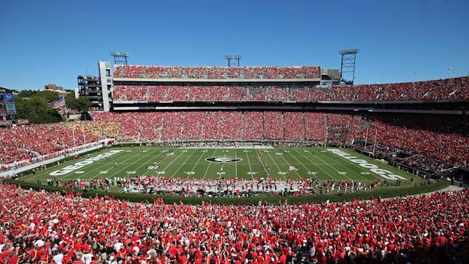 Georgia, right, kicks off against Missouri to start an NCAA college football game at Sanford Stadium Saturday, Oct. 12, 2013, in Athens, Ga