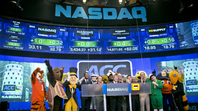 Atlantic Coast Conference mascots join ACC and NASDAQ officials for the ringing of the closing bell on Monday, July 1, 2013 in New York. The Atlantic Coast Conference officials and coaches visited the NASDAQ Market Site in Times Square to officially announce the addition of its three new members in Notre Dame, Pitt and Syracuse. (AP Photo/Bebeto Matthews)