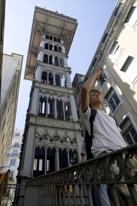 A man takes a picture in front of Lisbon's Santa Justa elevator