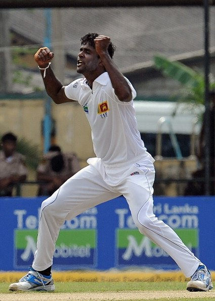 Sri Lanka's Shaminda Eranga celebrates the dismissal of New Zealand's Brendon McCullum during the first day of the second and final Test cricket match between Sri Lanka and New Zealand at the
