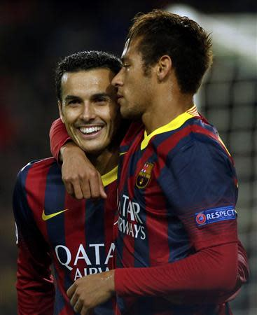 Barcelona's Pedro is congratulated by team mate Neymar after scoring a goal against Celtic during their Champions League soccer match in Barcelona