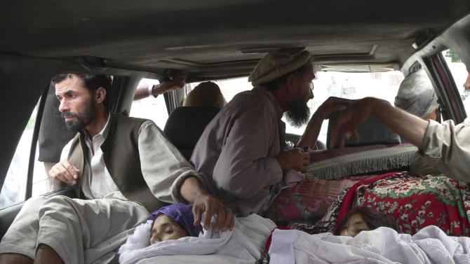Bodies of Afghan women are brought to a hospital in the Alingar district of Laghman province, east of Kabul, Afghanistan, Sunday, Sept 16, 2012. According to Afghan officials, airstrikes by NATO planes killed eight women and girls in Laghman province. Villagers from Alingar district drove the bodies to the provincial capital, claiming they were killed by NATO aircraft while they were out gathering firewood before dawn. (AP Photo/Khalid Khan)