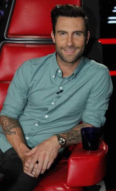 Adam Levine smiles from his coach's seat on 'The Voice,' May 20, 2013 -- NBC