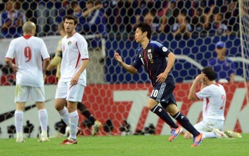 Japan forward Shinji Kagawa celebrates his goal against Jordan on June 8, 2012