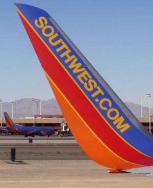 FILE - In this file photo taken Feb. 28, 2011, Southwest Airlines planes are shown at McCarran International Airport in Las Vegas. Boeing and Southwest Airlines today announced a firm order for 150 fuel-efficient 737 MAX airplanes. Southwest is the first customer to finalize an order for the 737 MAX and becomes the launch customer for the new-engine variant. The Dallas-based carrier also ordered 58 Next-Generation 737s. (AP Photo/Ted S. Warren, File)