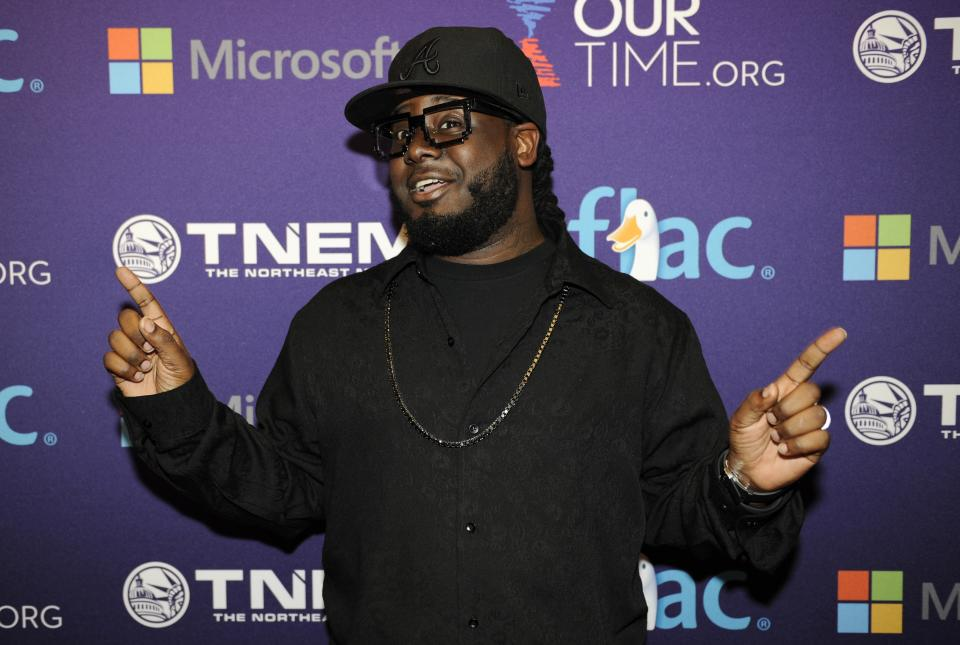 T-Pain arrives at the OurTime.org Inaugural Youth Ball Generation Now Party on Saturday, Jan. 19, 2013, in Washington. (Photo by Nick Wass/Invision/AP)