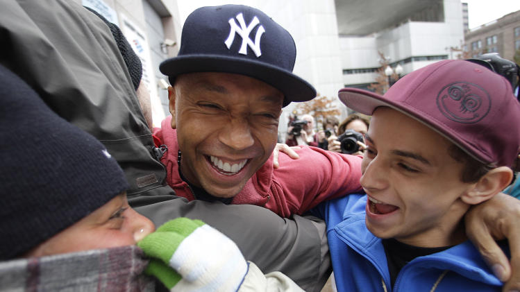 Hip-hop mogul and political activist Russell Simmons participates in an Occupy Boston group-hug with protestors at the encampment in Boston, Tuesday afternoon, Nov. 15, 2011. (AP Photo/Stephan Savoia)