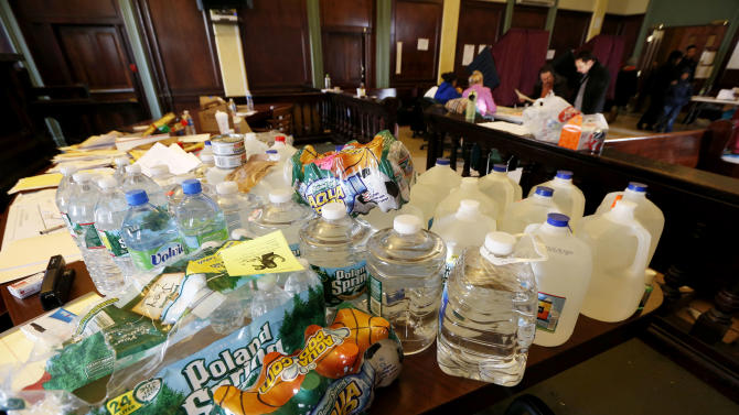 Bottled water sits on a table in a room at Hoboken City Hall as residents cast their votes on Election Day, Tuesday, Nov. 6, 2012, in Hoboken, N.J. New Jersey Gov. Chris Christie signed a declaration allowing people displaced by Superstorm Sandy to vote in the general election at any polling place. However, such voters were not allowed to vote in local elections. (AP Photo/Julio Cortez)