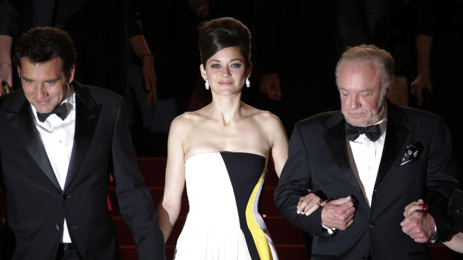 From left, actors Clive Owen, Marion Cotillard and James Caan leave following the screening of Blood Ties at the 66th international film festival, in Cannes, southern France, Monday, May 20, 2013. (AP Photo/Lionel Cironneau)