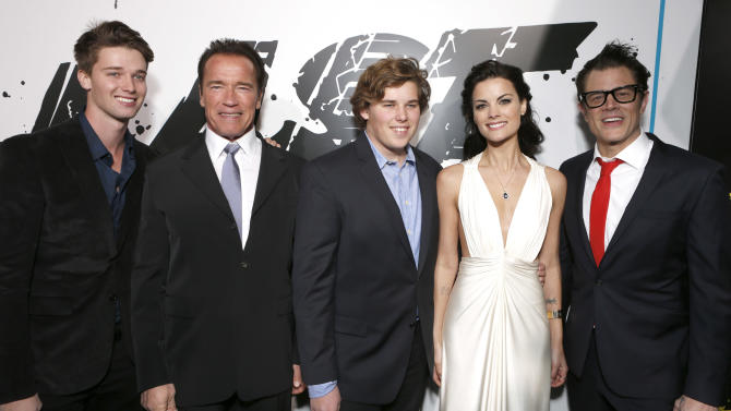 "Patrick Schwarzenegger, Arnold Schwarzenegger, Chris Schwarzenegger, Jaimie Alexander and Johnny Knoxville attend the LA premiere of ""The Last Stand"" at Grauman's Chinese Theatre on Monday, Jan. 14, 2013, in Los Angeles. (Photo by Todd Williamson/Invision/AP)"