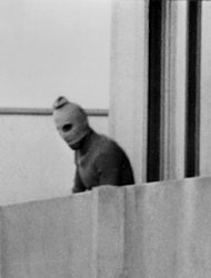One of the eight Palestinian terrorists comprising the Black September group stands on a balcony of the Olympic village during a standoff after they kidnapped nine members of the Israeli Olympic team and killed two others September 5, 1972 in Munich, Germany. All the hostages were killed after a pitched battle at Munich Airport the next day. September 6, 2002 marks the 30th anniversary of the botched rescue attempt in which the hostages died. (Photo by Getty Images)