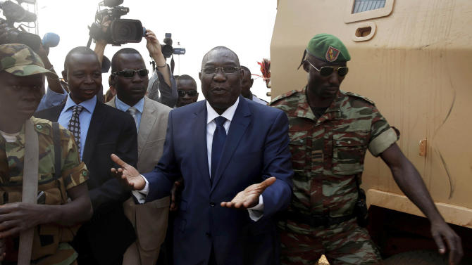FILE _ This is a Thursday Dec. 19, 2013 file photo of Michel Djotodia, Central African Republic's president, as he walks back to the Chadian armored vehicle he arrived in following his meeting with US Ambassador to the United Nations Samantha Power at the airport in Bangui, Central African Republic. Djotodia, agreed to resign Friday Jan. 10, 2014 along with his prime minister, regional officials announced. The move comes following growing pressure for Djotodia to step aside and should help placate the armed militias who have used to violence to seek his ouster. However, his departure could also create an even greater power vacuum in a land that has long known coups and dictatorship. (AP Photo/Jerome Delay, File)