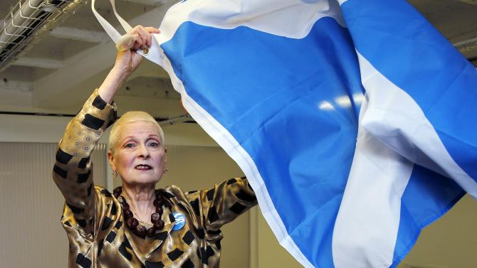 Designer Vivienne Westwood poses with a Scottish flag backstage before the presentation of her Vivienne Westwood Red Label Spring/Summer 2015 collection during London Fashion Week